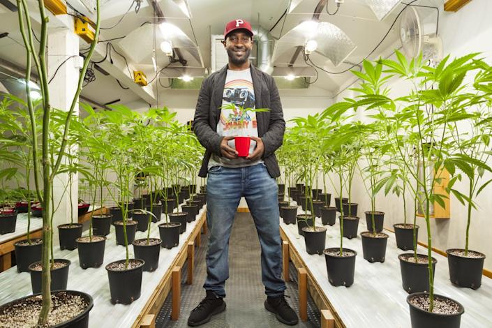 Jesce Horton in the grow room at Panacea Valley Gardens in Portland, Ore. (Photo: Robbie McClaran/Redux for Yahoo News)