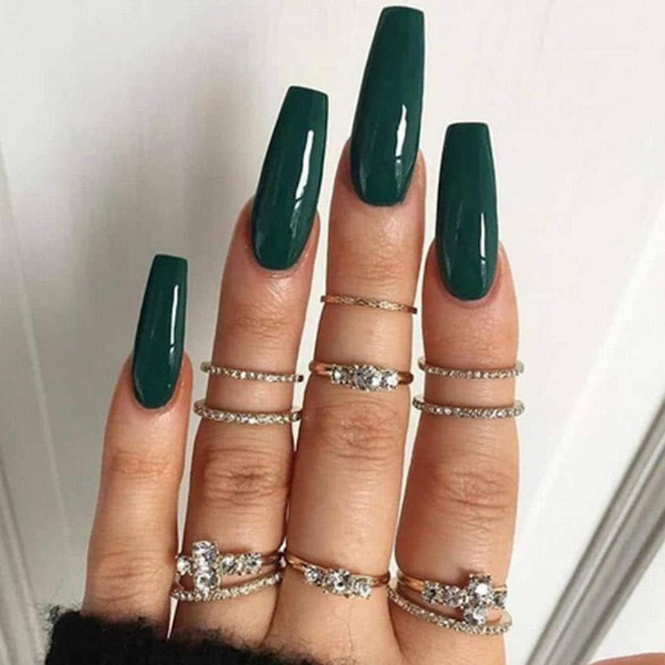 "<p>If you follow <a href=""https://www.allure.com/gallery/kylie-jenner-best-manicures-nail-art?mbid=synd_yahoo_rss"" rel=""nofollow noopener"" target=""_blank"" data-ylk=""slk:Kylie Jenner's ever-evolving manicures"" class=""link rapid-noclick-resp"">Kylie Jenner's ever-evolving manicures</a>, you'll notice that her preferred shape is <a href=""https://www.allure.com/story/popular-nail-shapes?mbid=synd_yahoo_rss"" rel=""nofollow noopener"" target=""_blank"" data-ylk=""slk:ballerina"" class=""link rapid-noclick-resp"">ballerina</a> (also known as coffin), which is the name for a tapered, square cut. If you're curious about trying it out for yourself, these Favelo Ballerina Press-On Nails will only run you $10 <em>at most.</em> The 24-piece sets come in nine glossy shades, including an alluring forest green (pictured above) and bold neon green. They're compatible with the included adhesive tape or whatever glue you already own. When it comes to removal, soak your nails in warm water for two minutes to loosen up the tape to avoid leaving marks on your natural nails.</p> <p><strong>$7 to $10</strong> (<a href=""https://www.amazon.com/Favelo-Coffin-Ballerina-Acrylic-Accessories/dp/B08BNNMKXH"" rel=""nofollow noopener"" target=""_blank"" data-ylk=""slk:Shop Now"" class=""link rapid-noclick-resp"">Shop Now</a>)</p>"