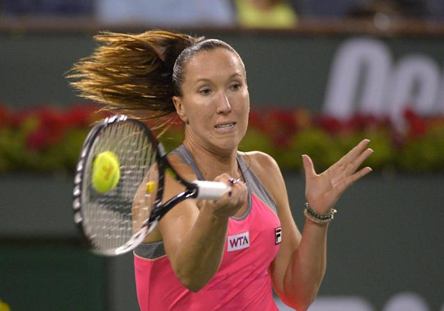 Jelena Jankovic, of Serbia, returns a shot to Agnieszka Radwanska, of Poland, during their match at the BNP Paribas Open tennis tournament on Wednesday, March 12, 2014, in Indian Wells, Calif. (AP Photo/Mark J. Terrill)