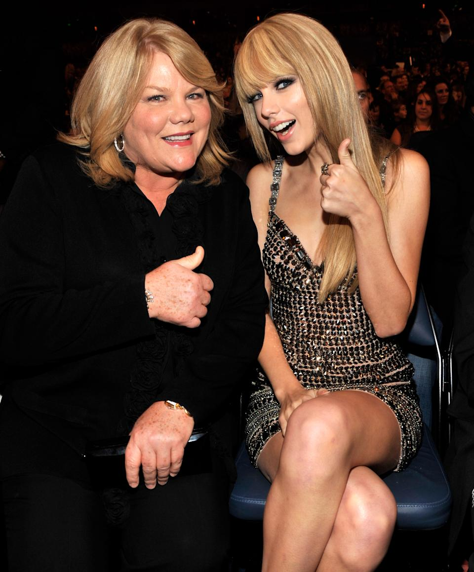 Andrea Swift and Taylor Swift in the audience at the 2010 American Music Awards held at Nokia Theatre L.A. Live on November 21, 2010 in Los Angeles, California.  (Photo by Mazur AMA 2010/WireImage)