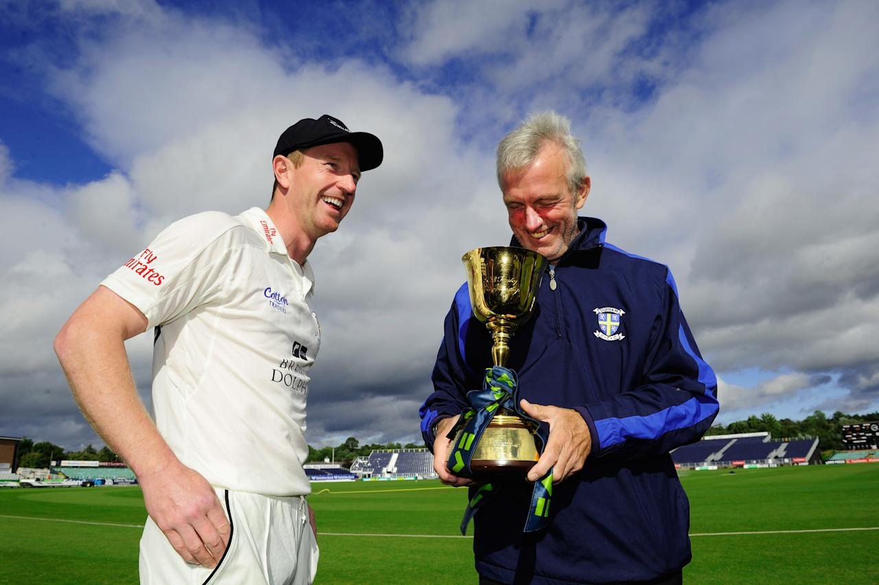 CHESTER-LE-STREET, ENGLAND - SEPTEMBER 19:  Durham coach Geoff Cook (r) and captain Paul Collingwood share a joke after winning the LV County Championship Division One title after day three of the LV County Championship Division One match between Durham and Nottinghamshire at The Riverside on September 19, 2013 in Chester-le-Street, England.  (Photo by Stu Forster/Getty Images)