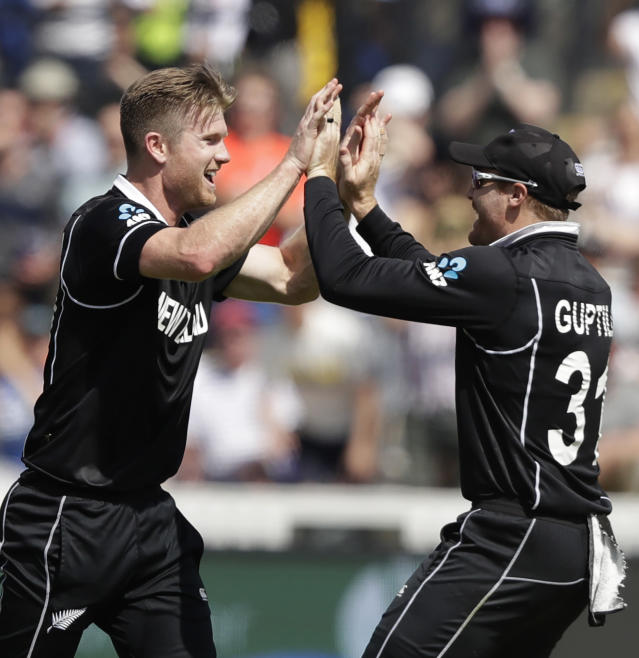 New Zealand's James Neesham, left, celebrates with teammate New Zealand's Martin Guptill after taking the wicket of Australia's Glenn Maxwell caught and bowled during the Cricket World Cup match between New Zealand and Australia at Lord's cricket ground in London, Saturday, June 29, 2019. (AP Photo/Matt Dunham)