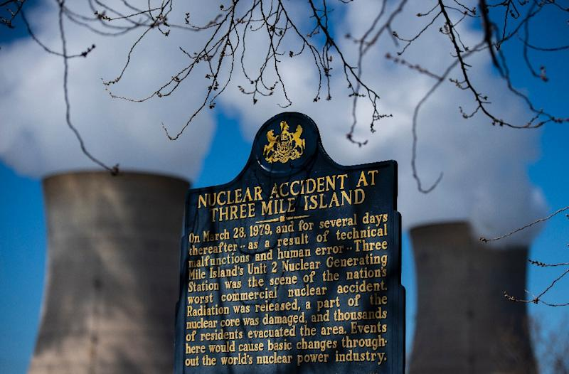 A plaque recounts the 1979 accident at Three Mile Island as steam rises from the cooling towers at the nuclear plant (AFP Photo/Andrew CABALLERO-REYNOLDS)