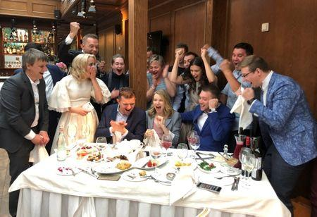Participants of a wedding ceremony celebrate the victory of Russia over Spain in their soccer World Cup Round of 16 match in Pushkin