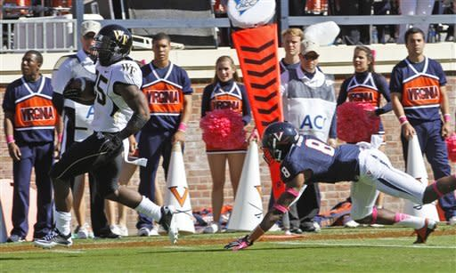 Wake Forest running back Josh Harris (25) scores as Virginia safety Anthony Harris (8) misses the tackle during the first half of an NCAA college football game at Scott Stadium in Charlottesville, Va., Saturday, Oct. 20, 2012. (AP Photo/Steve Helber)