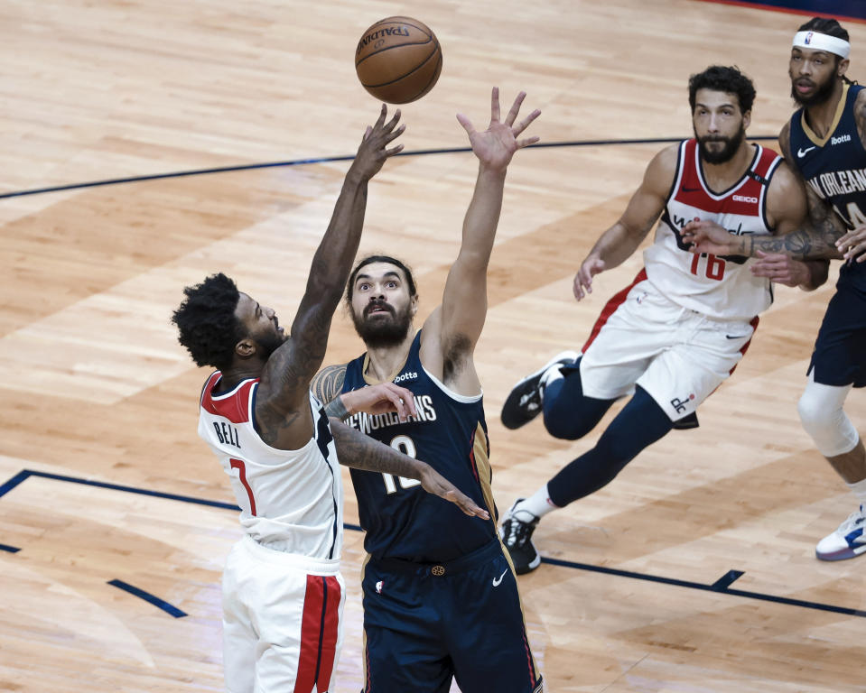 Washington Wizards guard Bradley Beal (3) shoots over New Orleans Pelicans center Steven Adams (12) in the second quarter of an NBA basketball game in New Orleans, Wednesday, Jan. 27, 2021. (AP Photo/Derick Hingle)