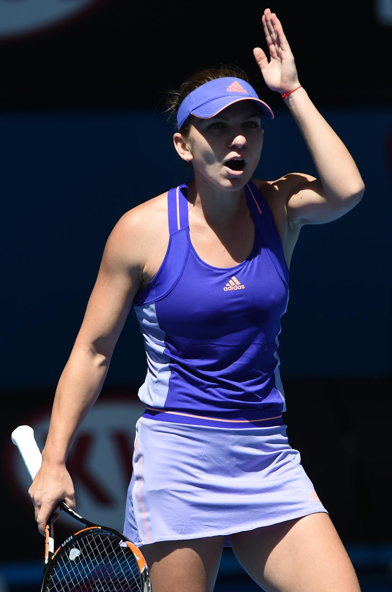 Halep advances to 2nd round at the Australian Open