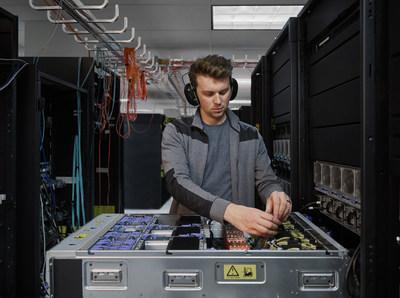 An engineer works on the IBM Power E1080. The IBM Power E1080 was designed from the ground-up for hybrid cloud environments. Photo credit: IBM