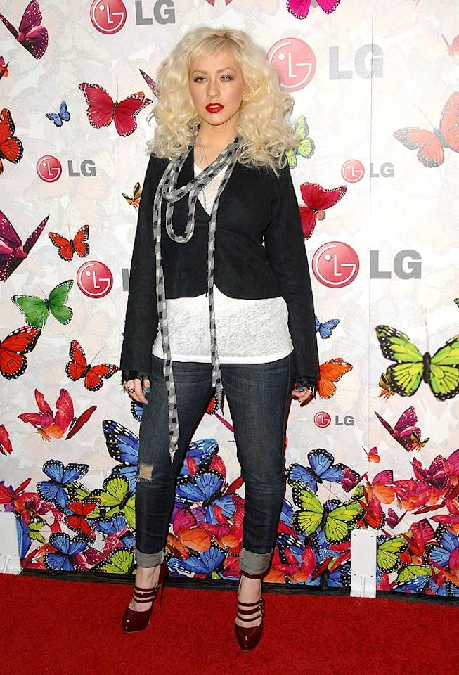"April: Christina Aguilera   The ""Beautiful"" songstress rarely disappoints on the red carpet, but she certainly did last spring at a mobile phone function thanks to her disastrous 'do, overly dramatic makeup, unnecessary scarf, cuffed jeans, and mismatched heels. John Shearer/<a href=""http://www.wireimage.com"" target=""new"">WireImage.com</a> - April 28, 2009"