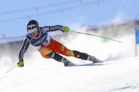 Canada's James Crawford competes during the super G portion of the men's combined race, at the alpine ski World Championships, in Cortina d'Ampezzo, Italy, Monday, Feb. 15, 2021. (AP Photo/Marco Trovati)