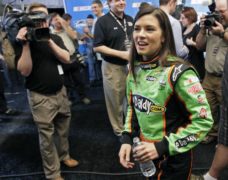 Auto racing driver Danica Patrick walks to an interview during NASCAR media day at Daytona International Speedway  Thursday, Feb. 16, 2012, in Daytona Beach, Fla. (AP Photo/John Raoux)