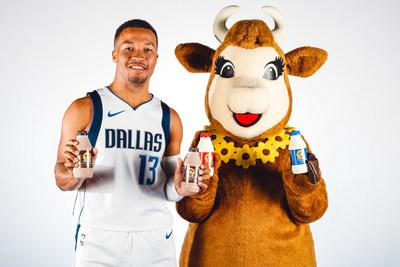 Dallas Mavericks Point Guard Jalen Brunson and Borden Dairy's Elsie the Cow toast to a new partnership.