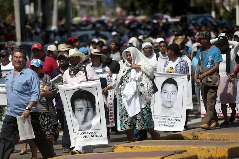 People take part in a protest over the missing students from Ayotzinapa in Acapulco, Guerrero State, Mexico, on February 10, 2015