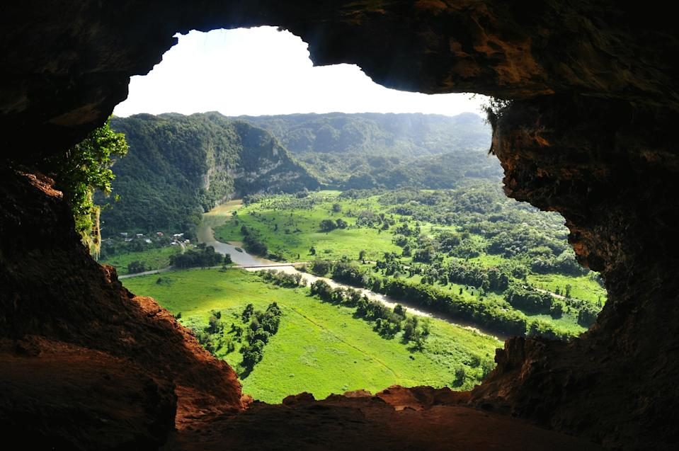 """<p><strong>Start from the top (no pun intended)—what are we looking at here?</strong><br> Cueva Ventana is a cave atop a limestone cliff in the mountainous town of Arecibo about an hour from San Juan. Its name translates to """"Cave Window:"""" One hikes up and looks through for a gorgeous view of mountains and river. For the adventurous types who love nature, this is a must-visit.</p> <p><strong>Got it. Is it easy to get around?</strong><br> Hiking the cave requires a moderate fitness level, so this isn't recommended for anyone with mobility issues.</p> <p><strong>Any tips before we plan a visit?</strong><br> Head over on a weekday, when non-resident tickets are $19 for a 90-minute guided tour.</p>"""