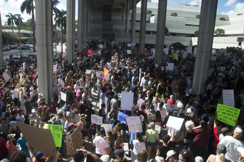 Protesters gathered at the Fort Lauderdale federal courthouse on Saturday to demand gun control. (Johanne Rahaman for HuffPost)