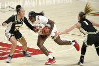 Maryland guard Ashley Owusu (15) drives to the hoop in front of Purdue guards Kayana Traylor (23) and Karissa McLaughlin (1) during the second half of an NCAA college basketball game, Sunday, Jan. 10, 2021, in College Park, Md. (AP Photo/Will Newton)