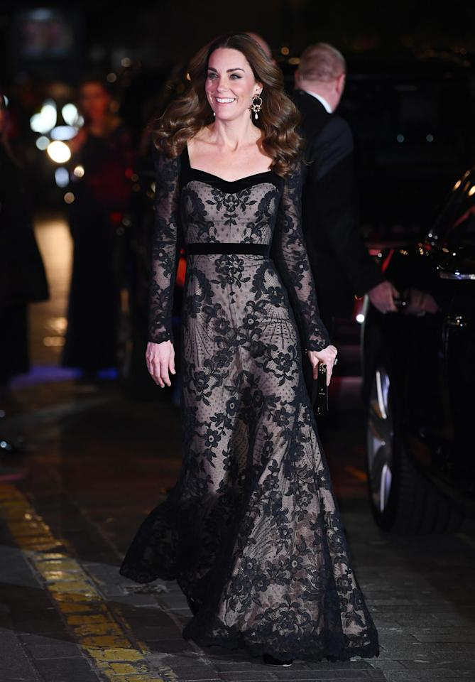"""<p>At the <a href=""""https://people.com/royals/kate-middletons-lace-gown-includes-a-sweet-nod-to-9th-anniversary-of-engagement-to-prince-william/"""">Royal Variety Performance</a> at the Palladium Theatre in London, the Duchess of Cambridge opted for a floor-length, black gown with intricate lace patterns by Alexander McQueen paired with dangling Erdem earrings.</p>"""
