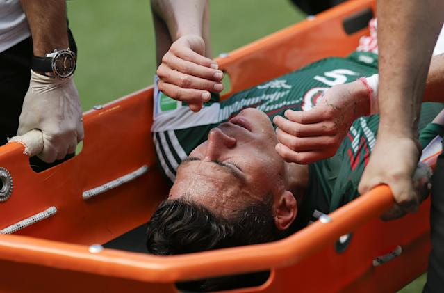 Mexico's Hector Moreno is carried off the pitch on a stretcher after an injury during the World Cup round of 16 soccer match between the Netherlands and Mexico at the Arena Castelao in Fortaleza, Brazil, Sunday, June 29, 2014. (AP Photo/Felipe Dana)