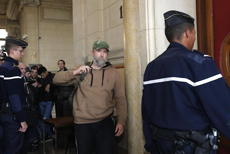Norwegian heavy metal rocker Kristian Vikernes, 40, arrives at the Paris courthouse for allegedly inciting racial hatred and other charges linked to his alleged anti-Semitic and xenophobic messages, Thursday, Oct. 17, 2013. Vikernes was detained in central France in July on suspected terrorism charges. Authorities had grown suspicious after his French wife bought several firearms, even though she had a permit, but turned up no plot. (AP Photo/Christophe Ena)