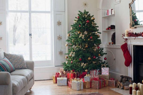 PHOTO: An undated stock photo shows a Christmas tree standing and gifts resting on the floor. (Tom Merton/Getty Images, STOCK PHOTO)