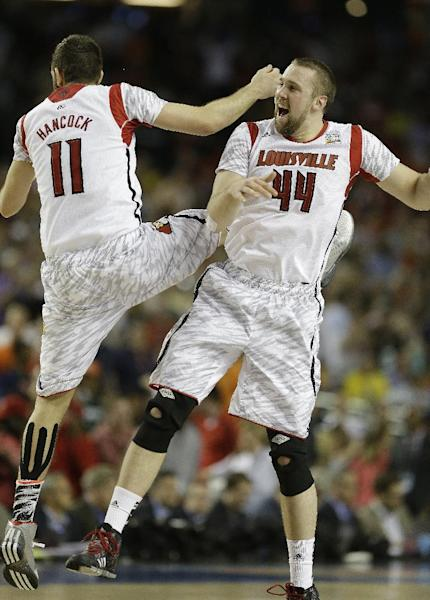 Louisville's Luke Hancock, left, and Louisville's Stephan Van Treese celebrate after the second half of the NCAA Final Four tournament college basketball semifinal game against Wichita State Saturday, April 6, 2013, in Atlanta. Louisville won 72-68. (AP Photo/Charlie Neibergall)