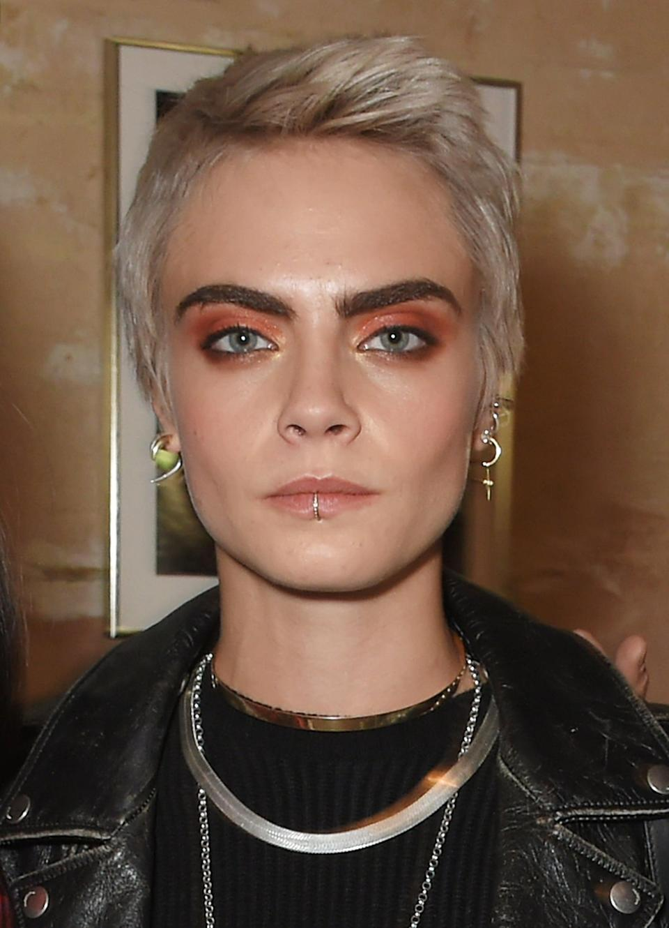 <p>Delevingne's returned to a shorter pixie for Burberry's Spring 2018 runway show, styling it up and away from her face, a decision that made her already bold brows look <em>even</em> bolder. </p>