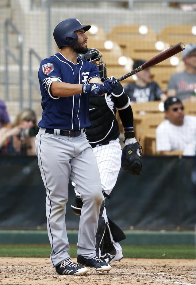San Diego Padres' Eric Hosmer watches his two-run home run against the Chicago White Sox during the fifth inning of a spring training baseball game Wednesday, March 21, 2018, in Glendale, Ariz. (AP Photo/Ross D. Franklin)