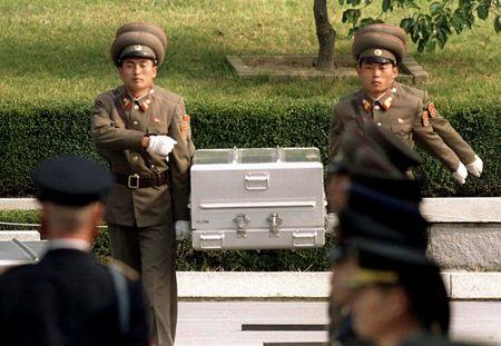 FILE PHOTO: North Korean soldiers carry coffin to the border with South Korea during repatriation ceremonies in Panmunjom, South Korea