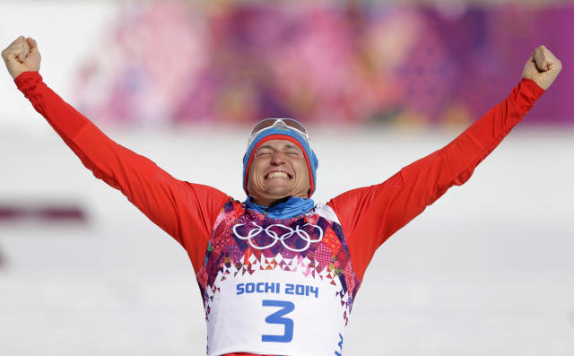 Russia's Alexander Legkov celebrates winning the gold during the flower ceremony of the men's 50K cross-country race at the 2014 Winter Olympics, Sunday, Feb. 23, 2014, in Krasnaya Polyana, Russia. (AP Photo/Matthias Schrader)