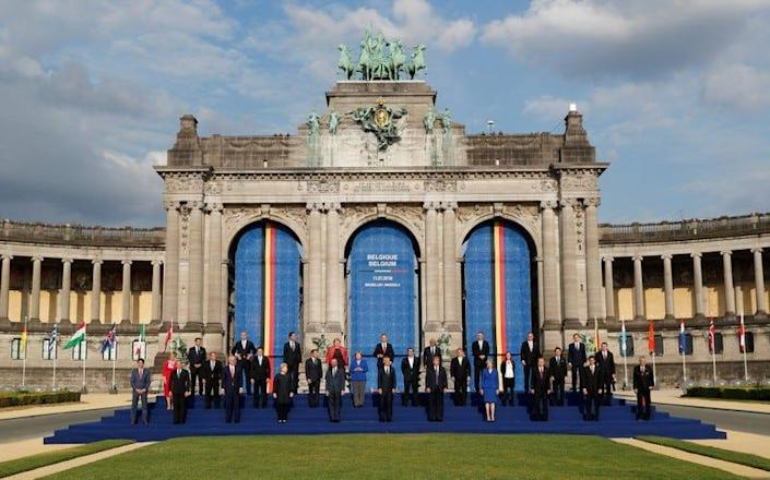 NATO leaders pose for a group photo in the park of the Cinquantenaire, during a NATO Summit, in central Brussels, Belgium July 11, 2018.  REUTERS/Yves Herman
