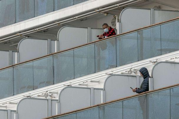 PHOTO: People stand on balconies on the Diamond Princess cruise ship while it is docked at Daikoku Pier in Yokohama, Japan, Feb. 7, 2020. (Carl Court/Getty Images)