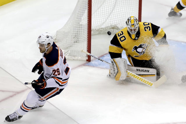 Edmonton Oilers' Leon Draisaitl (29) scores past Pittsburgh Penguins goaltender Matt Murray (30) during the first period of an NHL hockey game in Pittsburgh, Wednesday, Feb. 13, 2019. (AP Photo/Gene J. Puskar)
