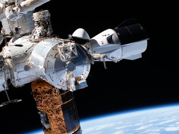 """SpaceX's Crew Dragon """"Endeavour"""" spaceship photographed by astronauts Bob Behnken and Chris Cassidy while performing a spacewalk on July 1, 2020."""