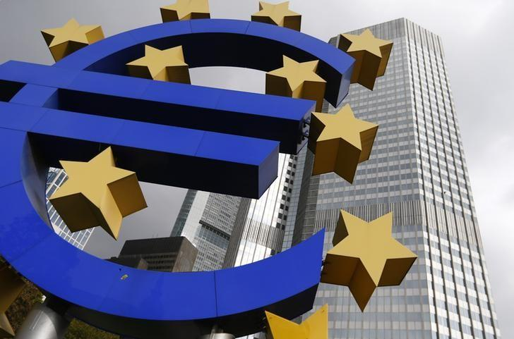 A euro logo sculpture stands in front the headquarters of the European Central Bank in Frankfurt