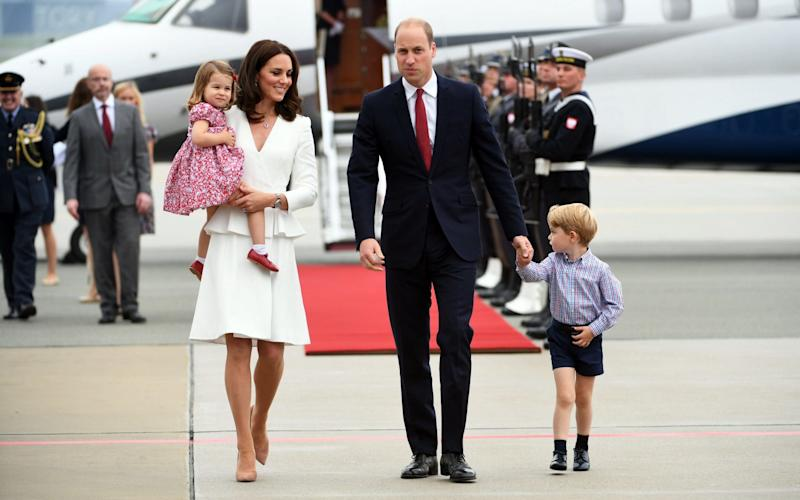 The Duke and Duchess of Cambridge and their children arrive on the runway at Warsaw - Credit: BARTLOMIEJ ZBOROWSKI/EPA