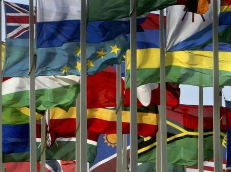 THE NATIONAL FLAGS OF THE COUNTRIES OF THE COMMONWEALTH FLY IN STRONG WINDS AT THE COMMONWEALTH ...