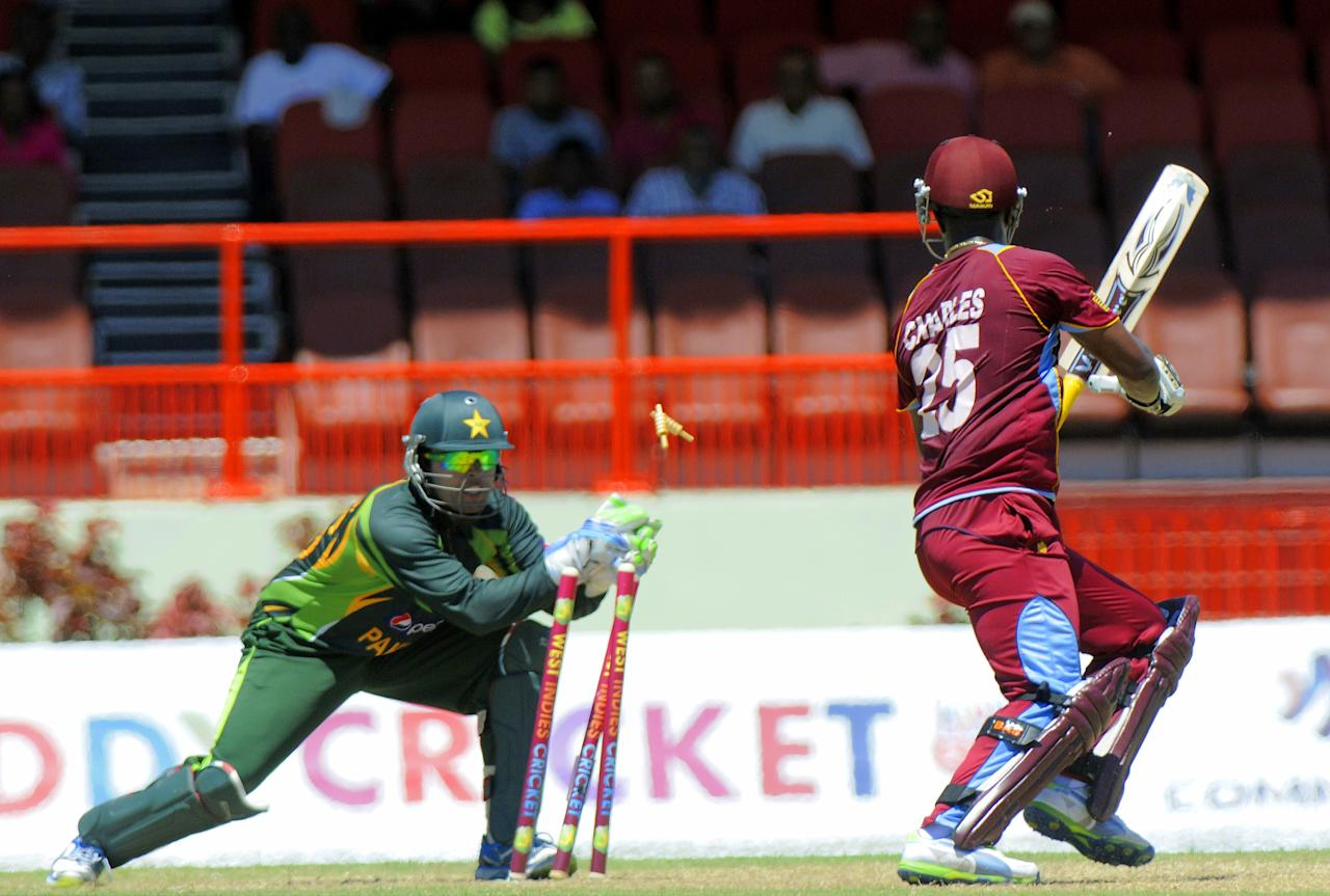 West Indies batsman Johnson Charles (R) stumped by Pakistan wicket-keeper Umar Akmal (L) off bowler Shahid Afridi for 31 runs during the 2nd ODI  during the 2nd ODI West Indies v Pakistan at Guyana National Stadium in Georgetown July 16, 2013. Score, WI 50/1 (10 ov).   AFP PHOTO / Randy Brooks        (Photo credit should read RANDY BROOKS/AFP/Getty Images)