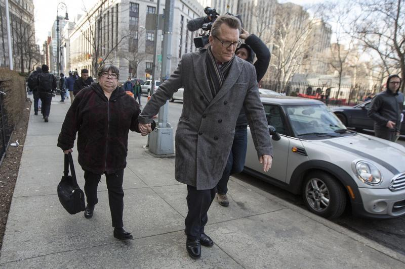 Bongiorno, former portfolio manager for Bernard L. Madoff Investment Securities LLC, exits the Manhattan Federal Court house in New York