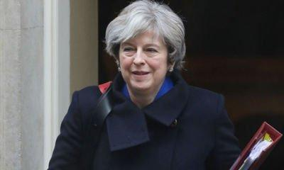 May urges execs to lobby for London at Brexit summit