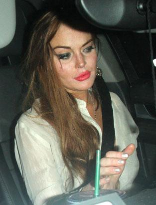 """Lindsay Lohan looked a tad too done up after a night of partying at the Chateau Marmont on July 21. She got into the driver's seat of her Porsche with a face full of lipstick and eyeliner. Lohan's latest project is """"The Canyons,"""" a movie she's filming with adult film star James Deen"""