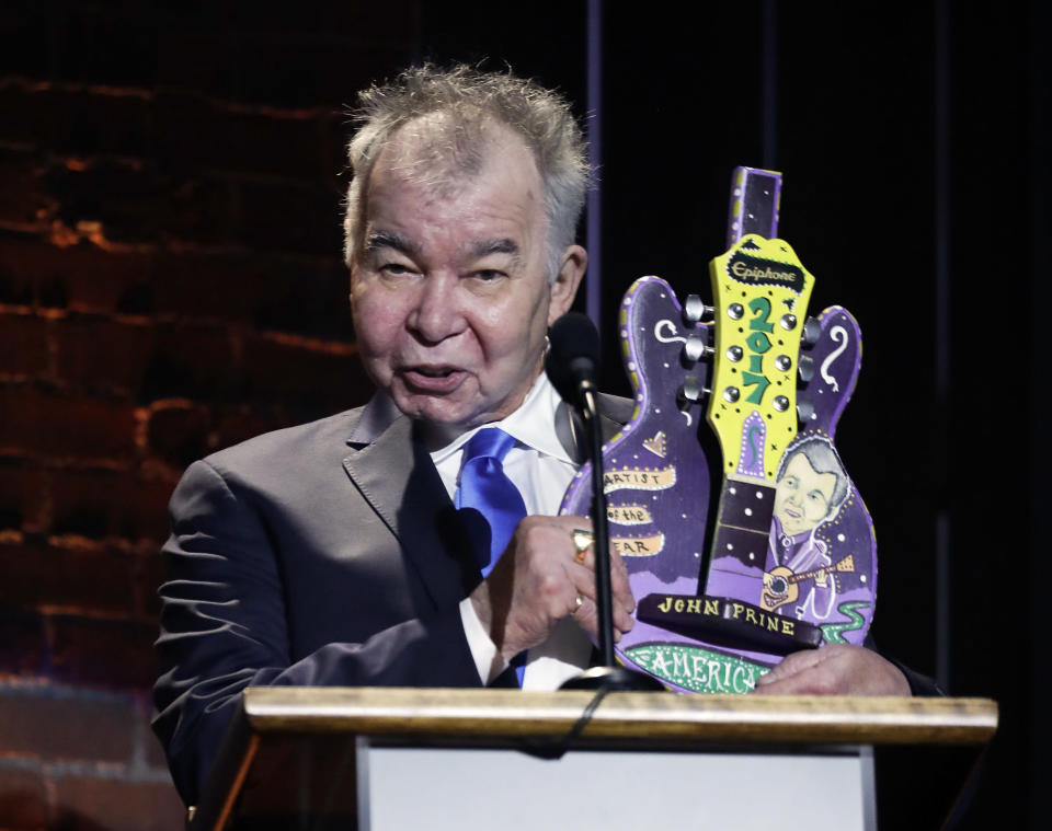 FILE - In this Sept. 13, 2017 file photo, John Prine accepts the artist of the year award during the Americana Honors and Awards show in Nashville, Tenn. Prine died Tuesday, April 7, 2020 from complications of the coronavirus. He was 73. (AP Photo/Mark Zaleski)
