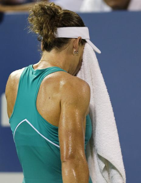 Samantha Stosur, of Australia, wipes her face prior to facing Victoria Duval, of the United States, for match point in the first round of the 2013 U.S. Open tennis tournament, Tuesday, Aug. 27, 2013, in New York. Duval won 5-7, 6-4, 6-4. (AP Photo/Charles Krupa)