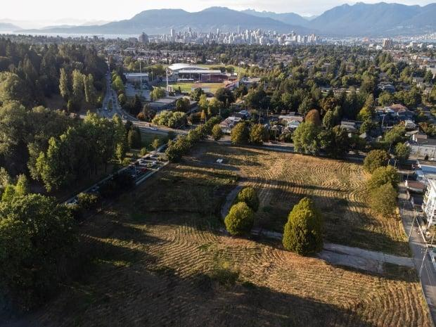 The Little Mountain lands in Vancouver sit between Queen Elizabeth Park and Main Street, just south of Nat Bailey Stadium. The six-hectare site has been empty since the controversial demolition of the existing buildings in 2009.  (Gian Paolo Mendoza/CBC - image credit)