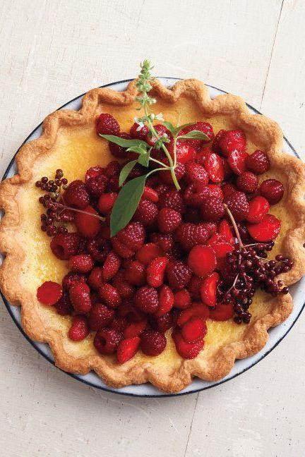 """<p>A few handfuls of raspberries, strawberries, and elderberries tossed in sugar rest atop a chilled custard infused with lemon basil. The herb, with its citrusy note, brightens the silky, rich filling.</p><p>Get the <a href=""""https://www.delish.com/uk/cooking/recipes/a32943307/lemon-basil-custard-pie-red-berries/"""" rel=""""nofollow noopener"""" target=""""_blank"""" data-ylk=""""slk:Lemon-Basil Custard Pie with Red Berries"""" class=""""link rapid-noclick-resp"""">Lemon-Basil Custard Pie with Red Berries </a>recipe. </p>"""