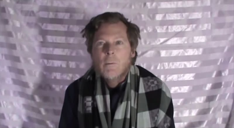 Timothy Weeks speaks to the camera while kept hostage by Taliban insurgents in an unknown location, said to be Afghanistan