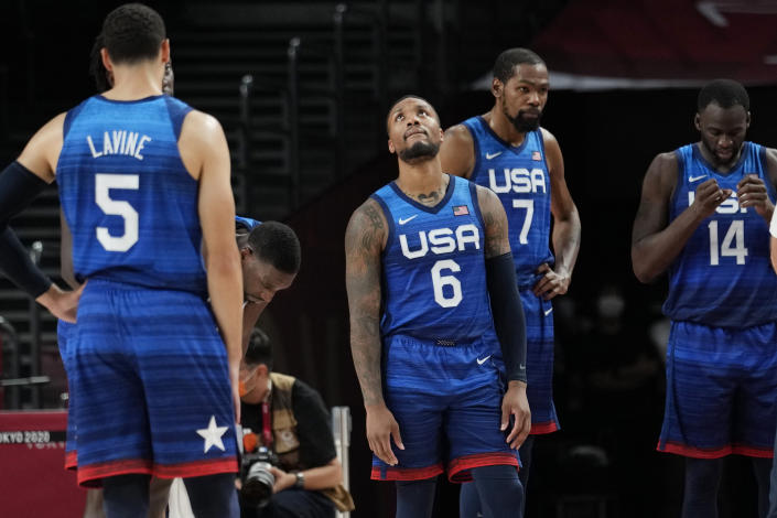 United States' Damian Lillard (6), Kevin Durant (7), and Draymond Green (16) their loss to France in wait for play to resume during their loss to France in a men's basketball preliminary round game at the 2020 Summer Olympics, Sunday, July 25, 2021, in Saitama, Japan. (AP Photo/Eric Gay)