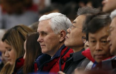 U.S. Vice President Mike Pence and South Korea's President Moon Jae-in attend short track speed skating events at the Gangneung Ice Arena in South Korea, February 10, 2018. REUTERS/John Sibley