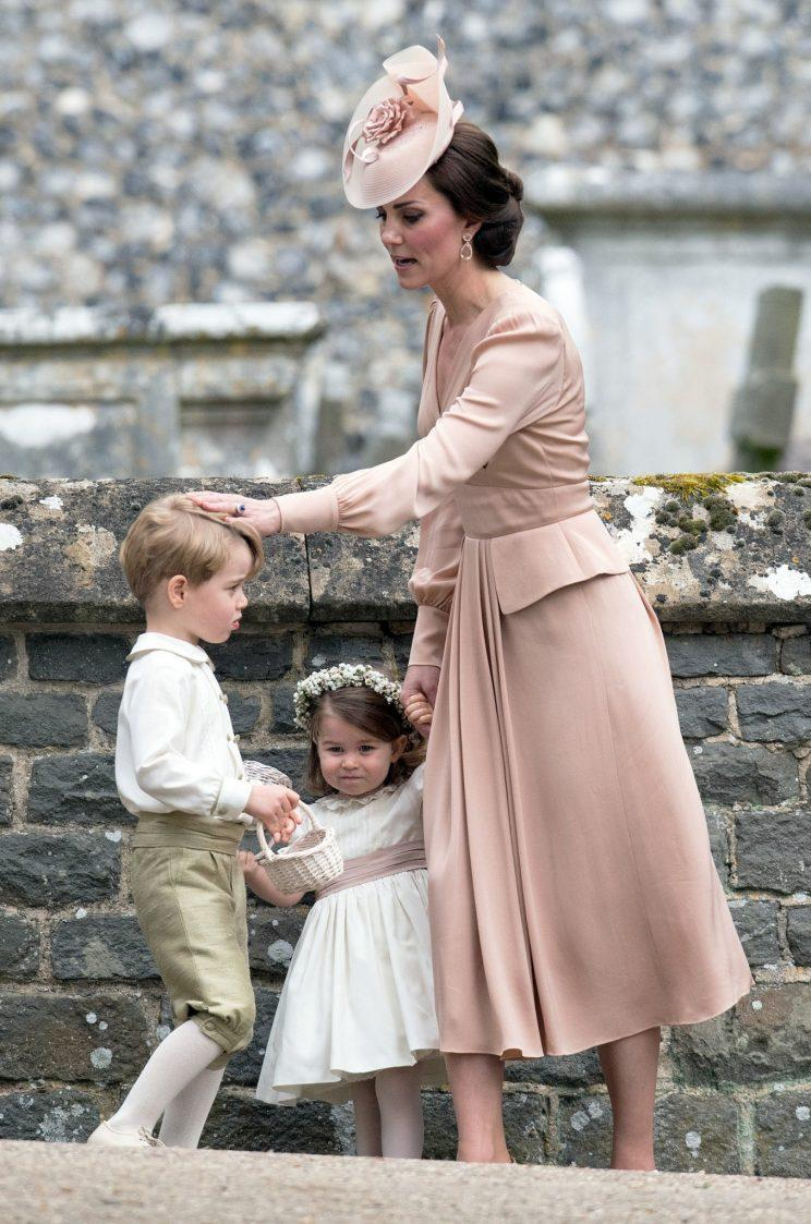 After being pictured having a serious chat with her son, George, the Duchess of Cambridge offers him some comfort [Photo: PA]