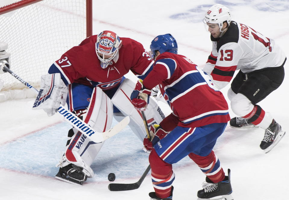 New Jersey Devils' Nico Hischier (13) moves in on Montreal Canadiens goaltender Keith Kinkaid as Canadiens' Shea Weber defends during overtime in an NHL hockey game in Montreal, Saturday, Nov. 16, 2019. (Graham Hughes/The Canadian Press via AP)