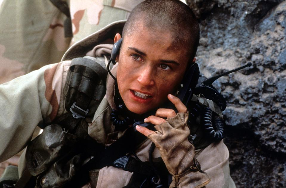 Demi Moore talking on walkie talkie in a scene from the film 'G.I. Jane', 1997. (Photo by Buena Vista/Getty Images)